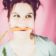 young teenage girl with carrot in her mouth - PhotoDune Item for Sale