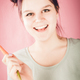 Smiling young teenage girl holding vitamin-rich carrot and looki - PhotoDune Item for Sale
