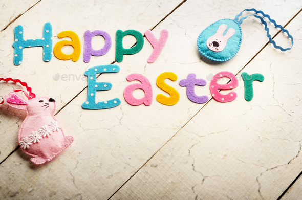 Happy Easter phrase made of fabric letters on white table - Stock Photo - Images