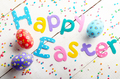 Happy Easter phrase made of fabric letters on white table - PhotoDune Item for Sale
