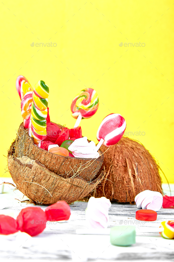 Many different candies in coconut - Stock Photo - Images