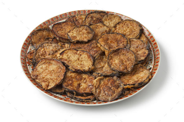 Moroccan dish with fried slices of eggplant - Stock Photo - Images