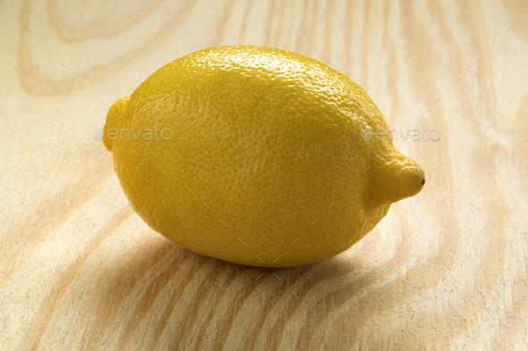 Single whole fresh lemon - Stock Photo - Images