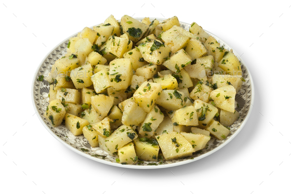 Moroccan dish with potato salad and herbs - Stock Photo - Images