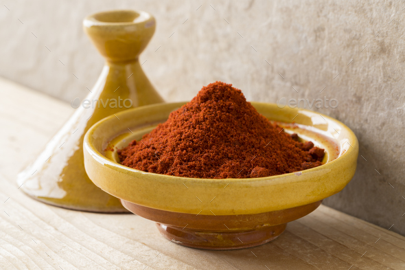 Traditional bowl with Moroccan dried ground paprika - Stock Photo - Images