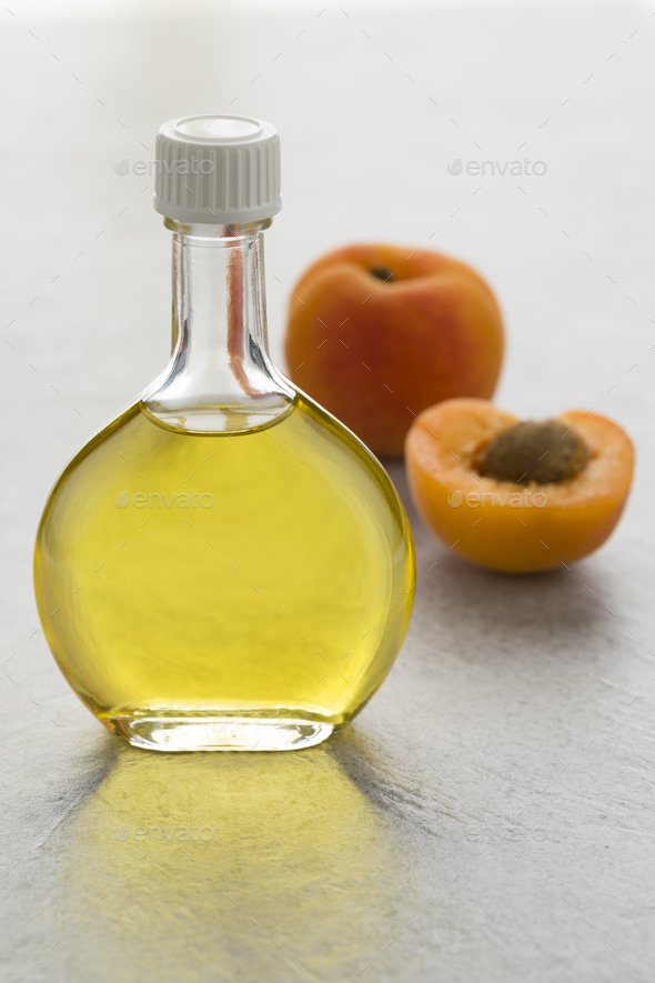 Glass bottle with cosmetic apricot kernel oil - Stock Photo - Images
