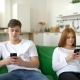 Man and Woman Ignoring Each Other in Their Mobile Phones in Their Home During the Morning. - VideoHive Item for Sale