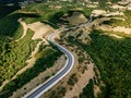 Aerial above view of a rural landscape with a curvy road running through it in Greece. - PhotoDune Item for Sale