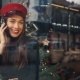 Happy Woman Talks on the Phone Sitting in a Cosy Cafe in Cold Winter Day - VideoHive Item for Sale