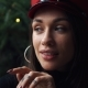 Charming Model Poses in Red Winter Hat Before a Christmas Tree - VideoHive Item for Sale