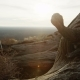 Tracking Shot of Two Trekkers Jumping Over Rocks in Desert  Sunrise - VideoHive Item for Sale