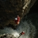 Two Men Canyoneering Ascending Up Ropes Over a Beautiful Waterfall - VideoHive Item for Sale