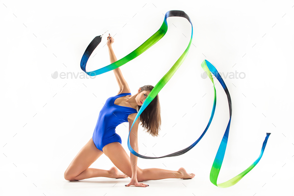 The portrait of beautiful woman gymnast on white - Stock Photo - Images