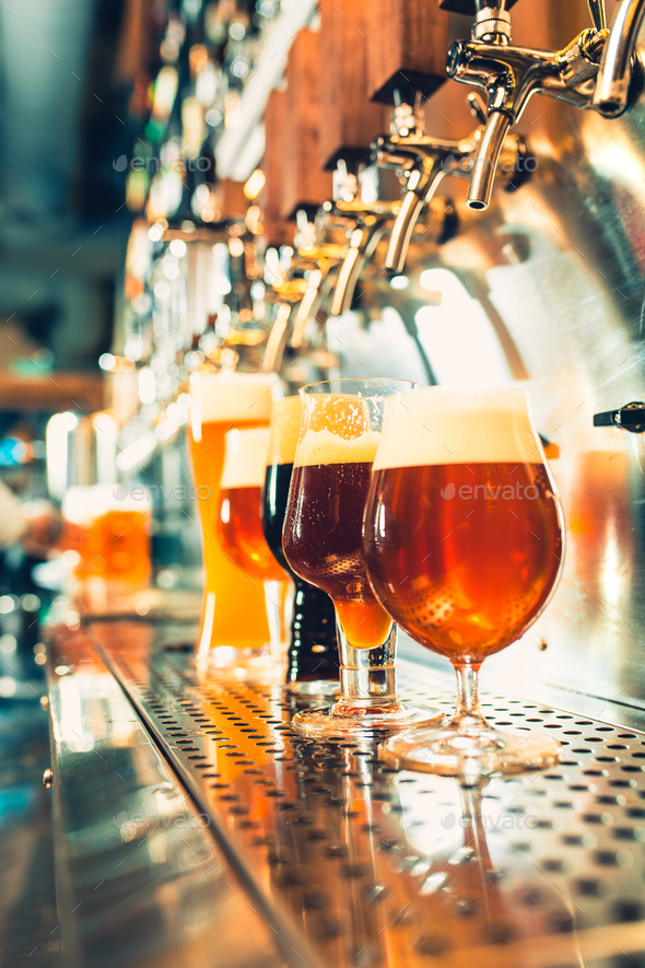 Beer taps in a pub - Stock Photo - Images