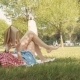 Woman Lay Down or Relaxing on Green Grass Reading Book in Summer or Spring - VideoHive Item for Sale