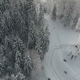 Snow Forest and Skiers on a Ski Lift Pov. Aerial View. Winter Alpine Ski Resort - VideoHive Item for Sale