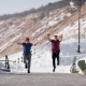 Two Athletes Are Doing a Flips Synchronously and in Parallel in a Park in Sunny Winter Day, Moving - VideoHive Item for Sale