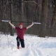 Young Sportsman with Rod Raised Over Head Is Making Lunges By Legs in a Snowy Winter Forest in - VideoHive Item for Sale