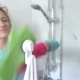 Woman with a Rubber Glove Cleans a Shower Stall - VideoHive Item for Sale