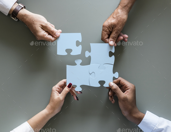 Business teamwork cooperation jigsaw isolated - Stock Photo - Images