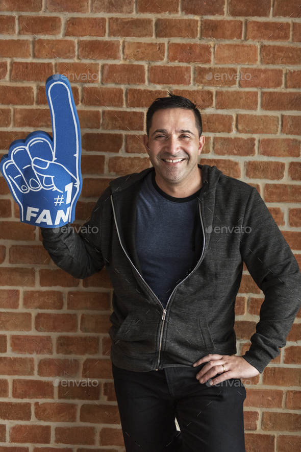 Man with sport number 1 fan glove - Stock Photo - Images