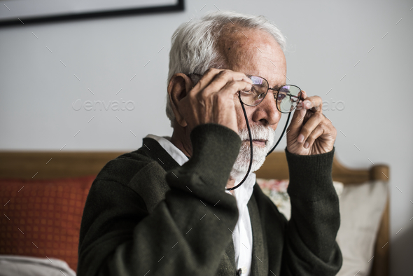 An elderly Indian man at the retirement house wearing a pair of - Stock Photo - Images