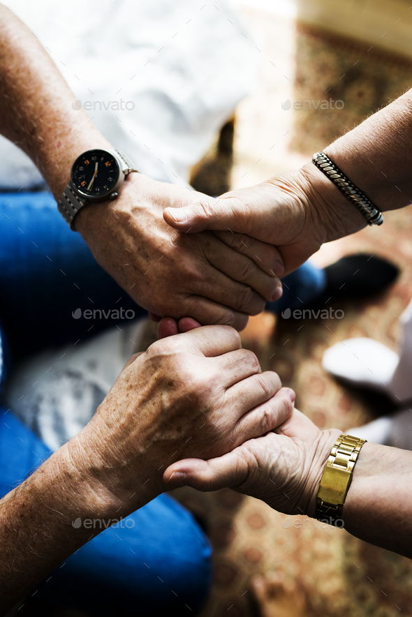 Senior couple holding hands together - Stock Photo - Images