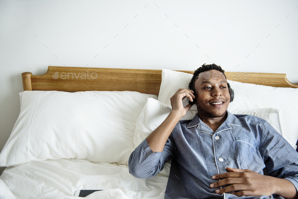 A man listening to music - Stock Photo - Images