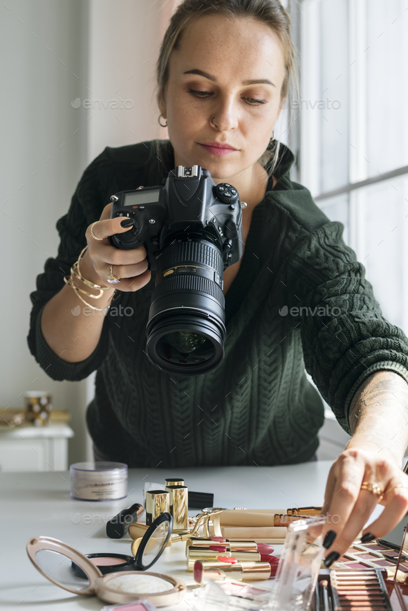 Beauty blogger taking photo of cosmetics - Stock Photo - Images