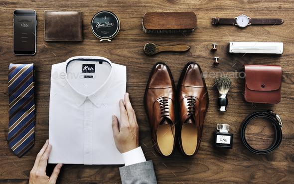 Businessman arranging his white shirt - Stock Photo - Images
