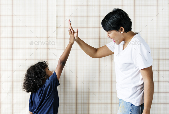 Young boy helping mom - Stock Photo - Images