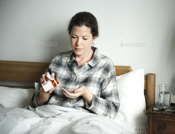 A woman taking medicine - Stock Photo - Images