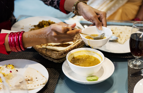 Family having Indian food - Stock Photo - Images