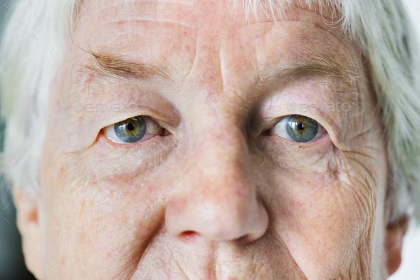 Portrait of white elderly woman closeup on eyes - Stock Photo - Images