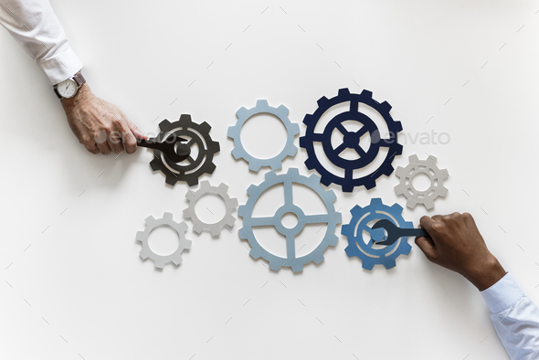Hands with support gears isolated on white background - Stock Photo - Images