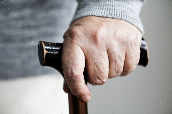 Closeup of elderly hand holding a walking stick - Stock Photo - Images