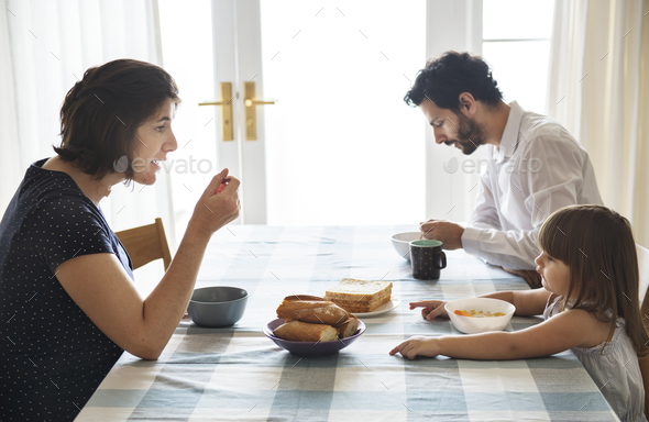 Family having breakfast together - Stock Photo - Images