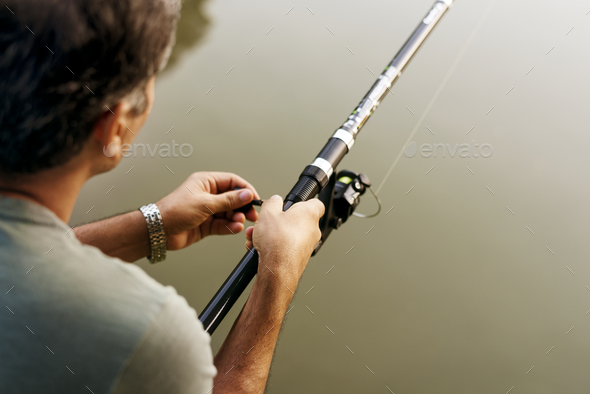 Man fishing in the jungle - Stock Photo - Images