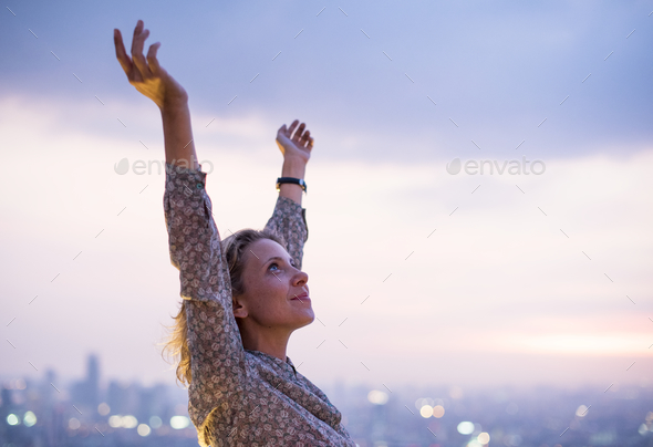 Happy woman at a rooftop - Stock Photo - Images