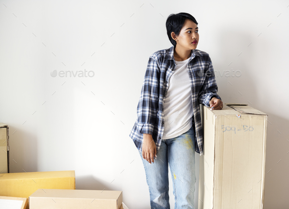 Woman moving to new house - Stock Photo - Images