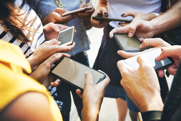 Young adult friends using smartphones together outdoors youth cu - Stock Photo - Images