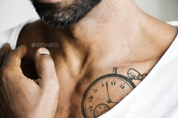 Close up of tattoo on the chest of a man - Stock Photo - Images