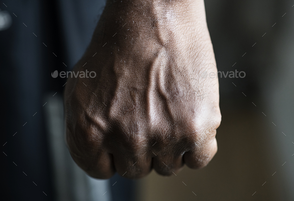 Closeup of a black hand in fist - Stock Photo - Images