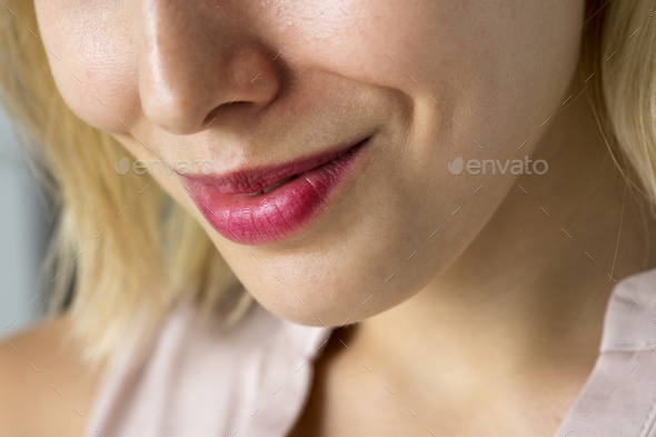 Closeup of smiling woman's smile - Stock Photo - Images