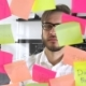 Man Post in Sticky Note While Meeting in Office on the Sticker Is Written IDEA - VideoHive Item for Sale