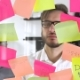 Man Post in Sticky Note While Meeting in Office, on the Sticker Is Written IDEA - VideoHive Item for Sale