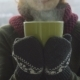 Woman Drinks Hot Tea or Coffee From Green Cup on Winter Morning - VideoHive Item for Sale