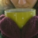 Woman Drinks Hot Tea or Coffee From Yellow Cup on Winter Morning - VideoHive Item for Sale