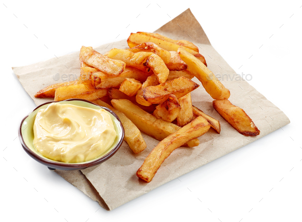 fried potatoes on wrapping paper - Stock Photo - Images