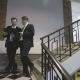 Businessmen Go Down the Stairs and Discuss Project - VideoHive Item for Sale
